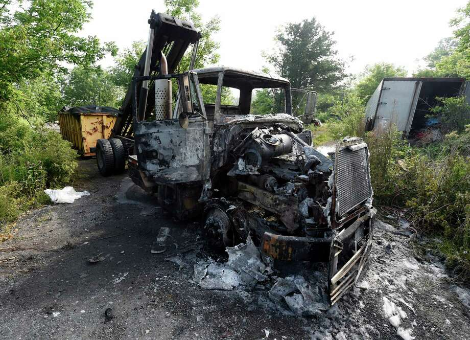 The burned out form of a rolloff truck sits at the scene of an unusual fire on Route 160 after an early morning incident Tuesday June 28, 2016 in Mariaville N.Y. (Skip Dickstein/Times Union) Photo: SKIP DICKSTEIN