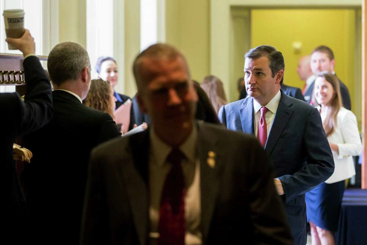 """Sen. Ted Cruz (right) leaves a luncheon on the same day he led a Senate subcommittee hearing in which he accused the administration of """"turning a blind eye to radical Islamic terrorism."""""""
