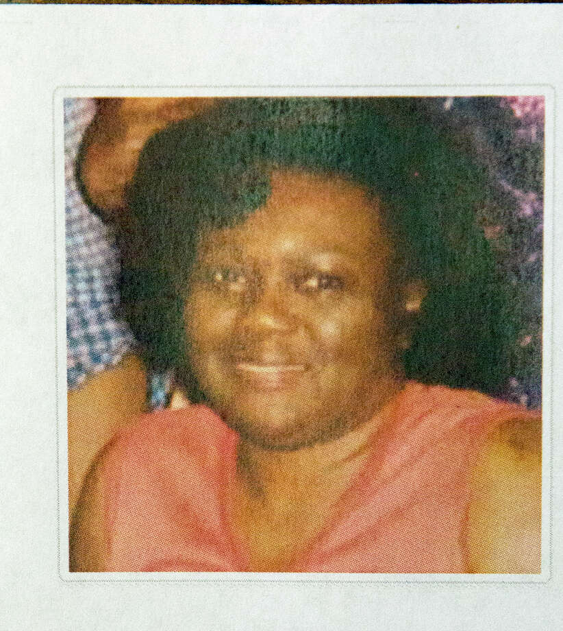 A photo of Edna L. Lawson is seen during a press conference, Friday, Aug. 8, 2014, in Houston. Mabrie Memorial Mortuary  mixed up the deceased bodies of two Houston mothers, Lawson and Pearlie Jean Deason and buried Deason's body in Lawson's cemetery plot at the VA cemetery on top of the body of Lawson's deceased husband, a World War II Veteran. Lawson passed away on July 19, 2014 and Mrs. Deason passed away on July 22, 2014.  (Cody Duty / Houston Chronicle) Photo: Cody Duty, Staff / © 2014 Houston Chronicle