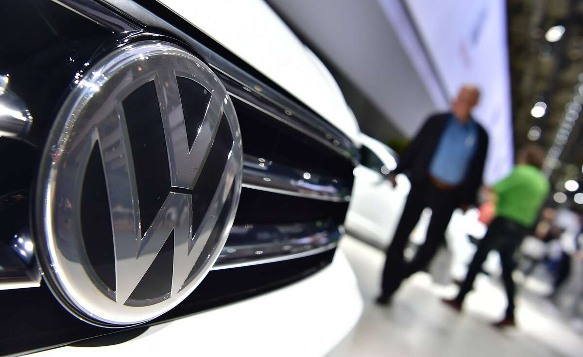 A Volkswagen logo is seen on a VW Tiguan on display during German carmaker Volkswagen shareholders' annual general meeting on June 22, 2016 in Hanover. The boss of embattled German auto giant Volkswagen issued an apology to angry shareholders over the emissions cheating scandal that has plunged the group into an unprecedented crisis. / AFP PHOTO / JOHN MACDOUGALLJOHN MACDOUGALL/AFP/Getty Images