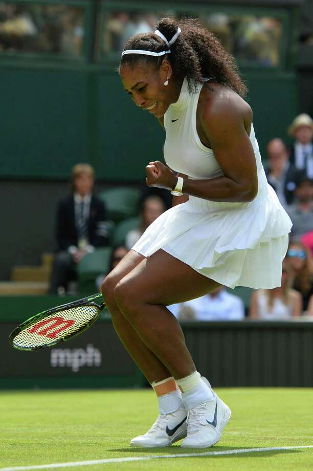 US player Serena Williams reacts after a point against Switzerland's Amra Sadikovic during their women's singles first round match on the second day of the 2016 Wimbledon Championships at The All England Lawn Tennis Club in Wimbledon, southwest London, on June 28, 2016. / AFP PHOTO / GLYN KIRK / RESTRICTED TO EDITORIAL USEGLYN KIRK/AFP/Getty Images Photo: GLYN KIRK / AFP or licensors