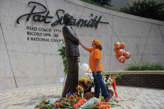 Teresa Olive of Knoxville visits a statue of Pat Summitt that fittingly stands tall on the Tennessee campus.