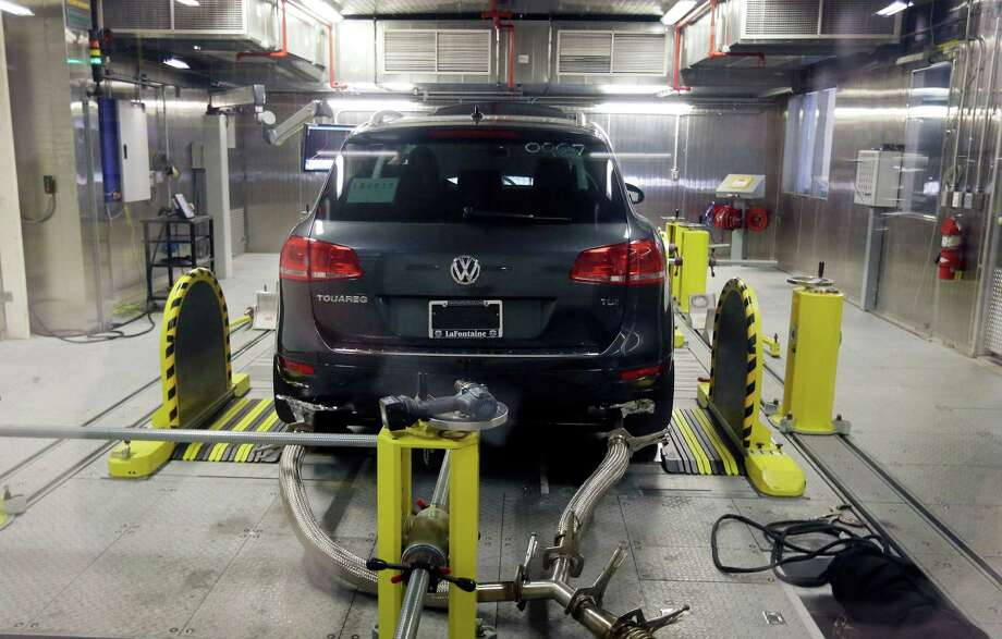 A Volkswagen Touareg diesel is tested last year in the Environmental Protection Agency's cold temperature facility in Ann Arbor, Mich. Volkswagen will spend more than $15 billion to settle consumer lawsuits and government allegations that it cheated on emissions tests. Photo: Carlos Osorio, STF