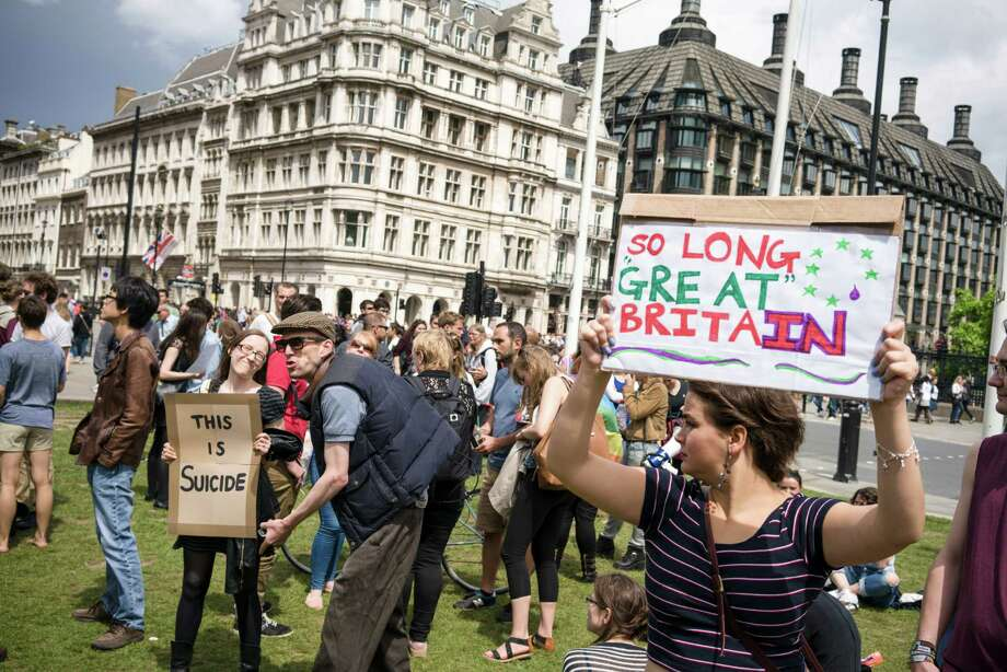 A supporter of the Brexit taunts pro-European Union demonstrators in London last week.  Photo: MARCO KESSELER, STR / NYTNS