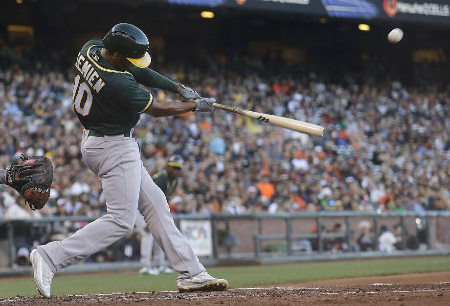 Oakland Athletics' Marcus Semien (10) hits a three-run home run off of San Francisco Giants pitcher Jeff Samardzija during the second inning of a baseball game in San Francisco, Monday, June 27, 2016. (AP Photo/Jeff Chiu) Photo: Jeff Chiu, Associated Press