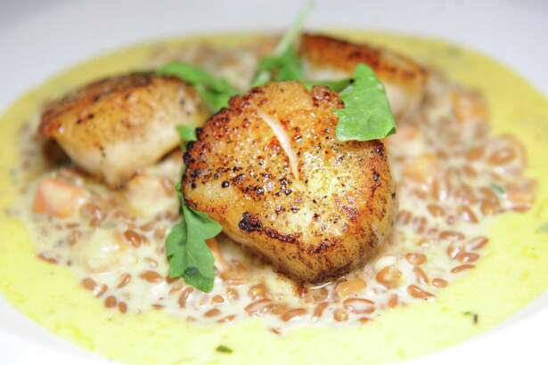 Seared Diver Scallop with sweet potato farro risotto and spicy butternut squash sugo on Friday, Nov. 6, 2015, at Campagna in Malta, N.Y. (Cindy Schultz / Times Union) ORG XMIT: MER2015110618380008