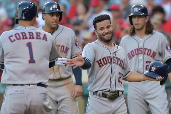 ANAHEIM, CA - JUNE 28:   Carlos Correa #1 of the Houston Astros is greeted by Jose Altuve #27 of the Houston Astros after hitting a 3-run home run off Tim Lincecum #55 of the Los Angeles Angels in the first inning of the game at Angel Stadium of Anaheim on June 28, 2016 in Anaheim, California.