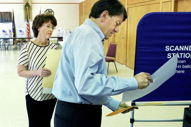Republican 19th congressional district hopeful John Faso and his wife Mary Frances, left, have trouble casting their votes as a discrepancy on the ballot caused Republican votes to be rejected by the voting machine at the St. Paul's Episcopal Church polling station Tuesday June 28,2016 in Kinderhook, NY.  (John Carl D'Annibale / Times Union)