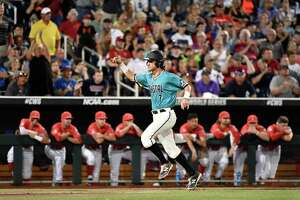 Coastal Carolina's Zach Remillard celebrates scoring on a G.K. Young two-run single in the  eighth inning in Game 2 of the NCAA Men's College World Series finals baseball game in Omaha, Neb., Tuesday, June 28, 2016. Young was out at second base. (AP Photo/Ted Kirk) ORG XMIT: NEPS125