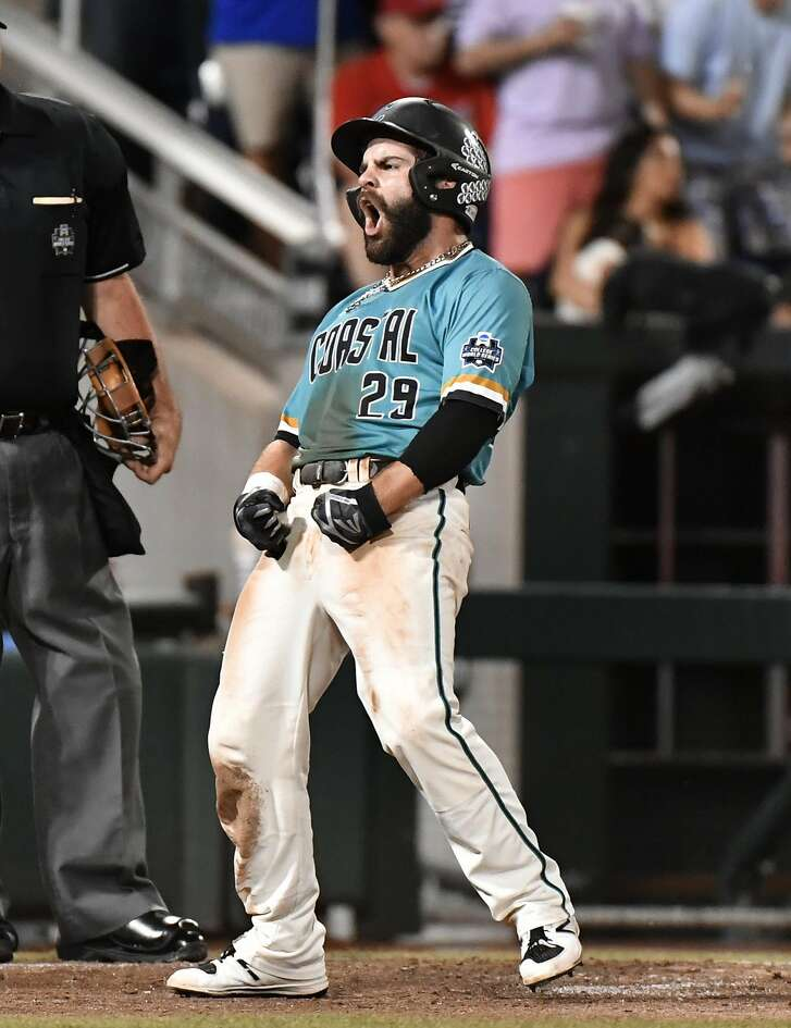 Coastal Carolina's Anthony Marks reacts to scoring on a Connor Owings single against Arizona in the eighth inning in Game 2 of the NCAA Men's College World Series finals baseball game in Omaha, Neb., Tuesday, June 28, 2016. (AP Photo/Ted Kirk)