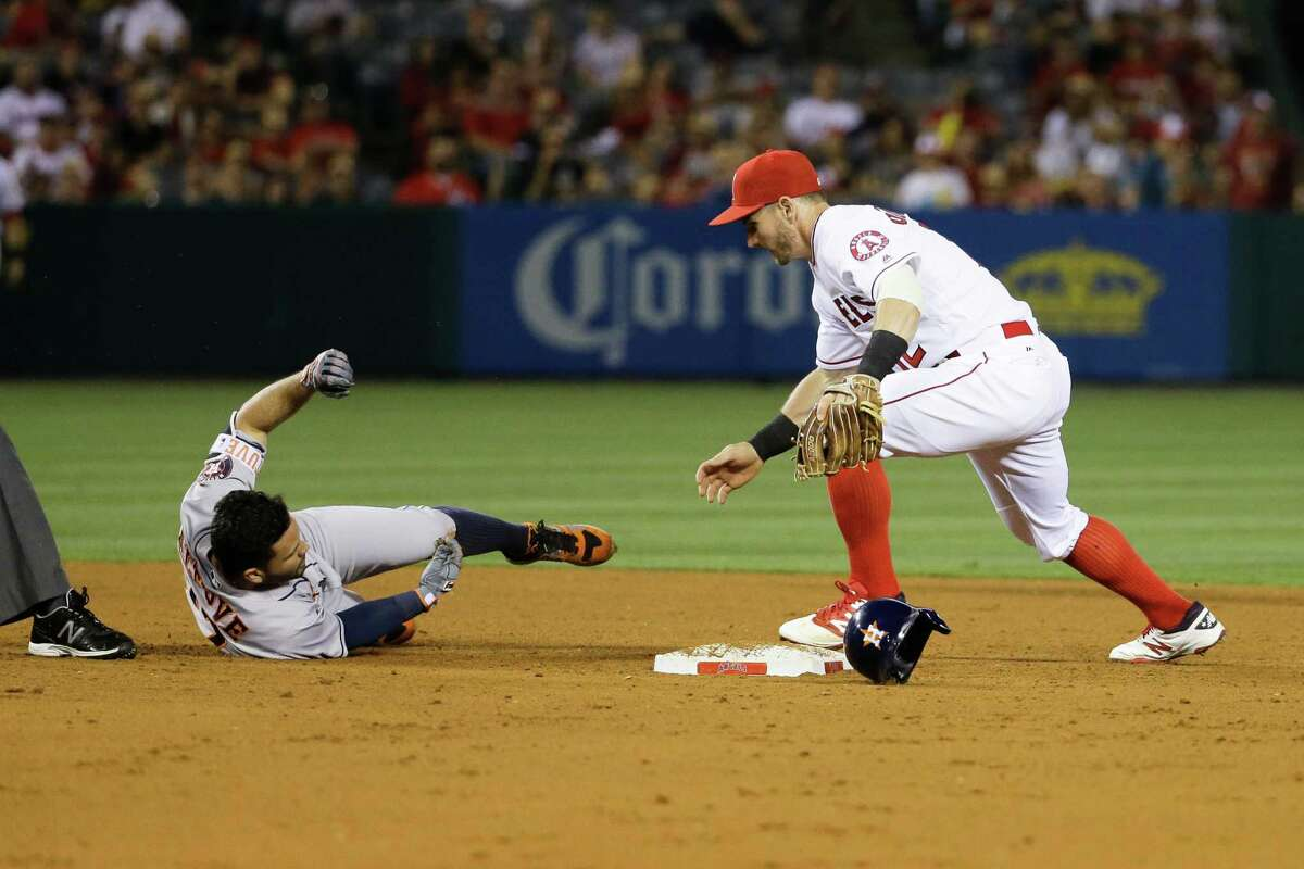 The Angels' Johnny Giavotella, right, tracks down Jose Altuve, who was out after sliding off second.
