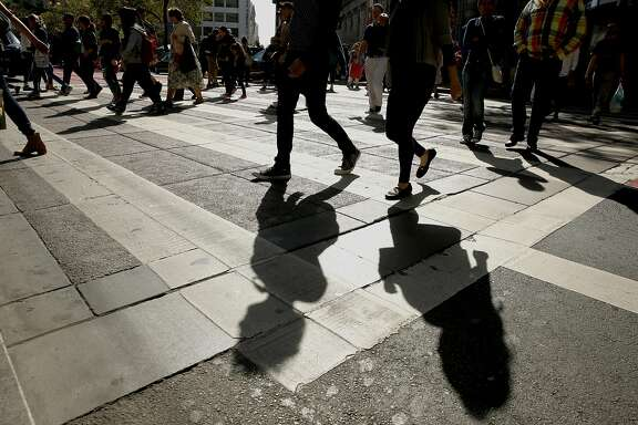 Pedestrians cross Market St. in downtown  San Francisco, California between Fourth and Fifth streets on Tues. June 28, 2016. Data from the safer Market Street project has shown fewer vehicles and safer behavior on the corridor since it took effect last August.