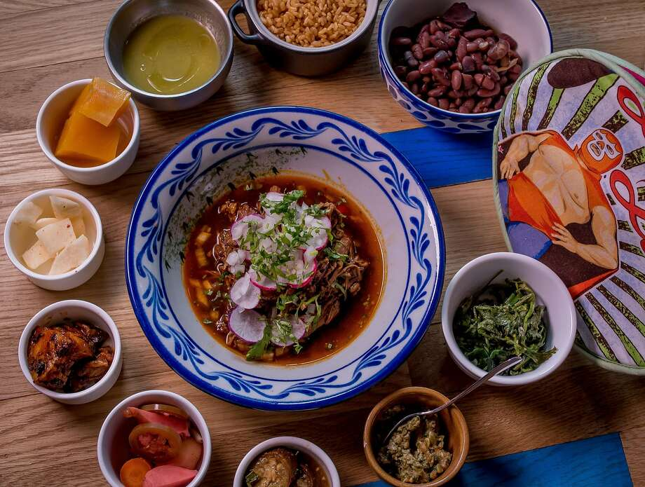 """The 10 """"little tastes,"""" from pickled vegetables to jicama with chile and lime, that accompany each large plate at Fenix in S.F. Shown here with a bowl of goat birria. Photo: John Storey, Special To The Chronicle"""