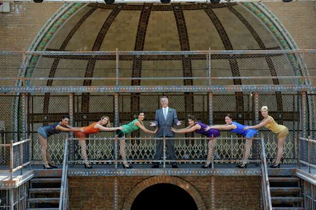 """Cast members of """"Chicago"""", Rick Roemer and the female ensemble, pose for a photo on the Washington Park Playhouse stage on Sunday, June 26, 2016, in Albany, N.Y.  Roemer plays the part of Billy Flynn.     (Paul Buckowski / Times Union)"""
