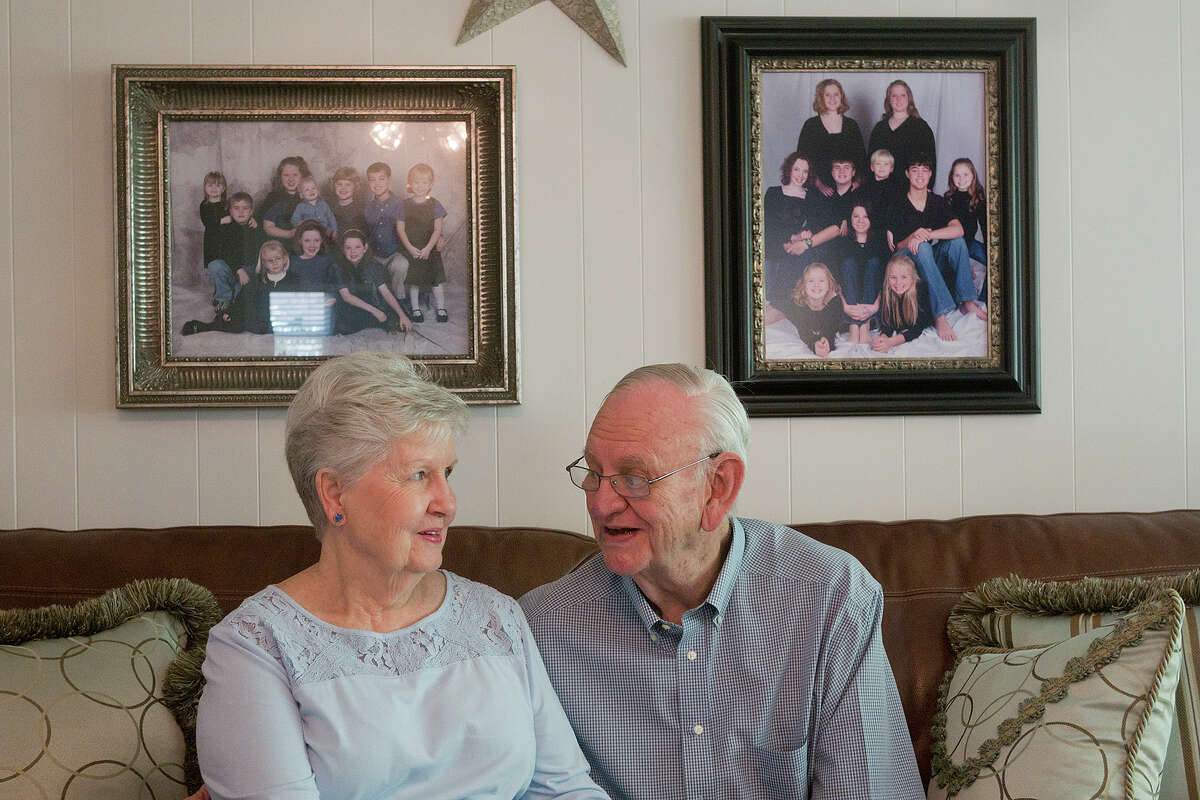 Wayne Schaper, Sr. and his wife Ruby chat against a backdrop of family photos in their Spring Shadows home. Schaper has retired from his 55-year career with Spring Branch ISD, where he was a teacher, coach, principal and trustee.