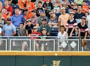 TCU center fielder Dane Steinhagen catches a fly ball by Coastal Carolina's G.K. Young during the seventh inning of an NCAA College World Series baseball game in Omaha, Neb., Friday, June 24, 2016. (AP Photo/Ted Kirk)