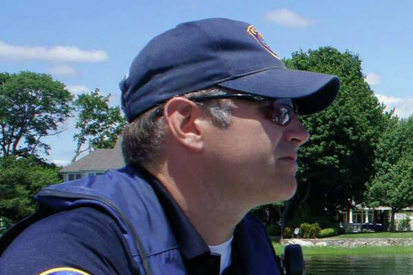 Westport Police Officer Robert Myer, seen here during a July 2011 patrol on the Saugatuck River, died on May 4, 2016 at his home in Newtown, Conn.