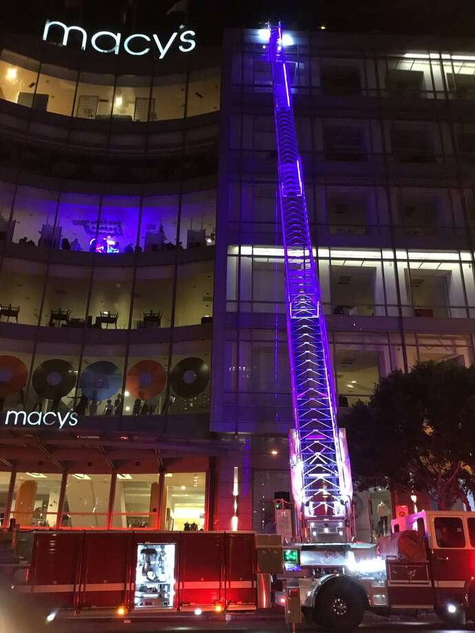 Firefighters attack a fire on the roof of the Macy's department store in San Francisco's Union Square. Photo: SFFD / /