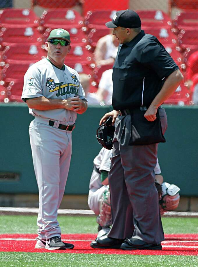 Tulane head coach David Pierce left, discusses a call with home plate umpire Mark Uyl right, during the third inning of Men's College baseball game action at Schroeder Park Friday, May 20, 2016, in Houston. Photo: James Nielsen, Houston Chronicle / © 2016  Houston Chronicle