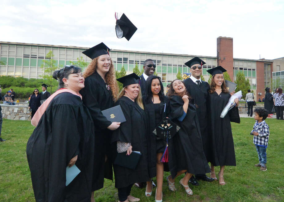 """Members of the Norwalk Community College class of 2016 in Norwalk Conn. in May 2016. On June 29, 2016, the Connecticut Higher Education Supplemental Loan Authority announced a """"Refi CT"""" program for student borrowers to refinance their debt. Photo: Alex Von Kleydorff / Hearst Connecticut Media / Connecticut Post"""
