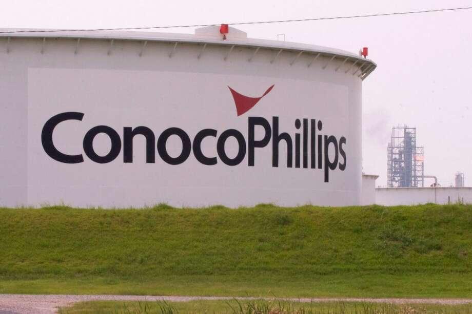 ConocoPhillips loses $3.4 billion; plans to cut spending - Houston ...