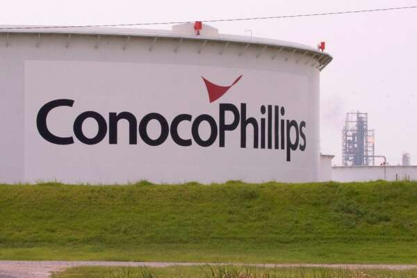 ConocoPhillips buys Burlington Resources for $35.6 billion.