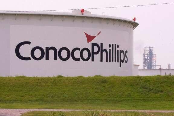 ConocoPhillips buys Burlington Resources for $35.6 billion.