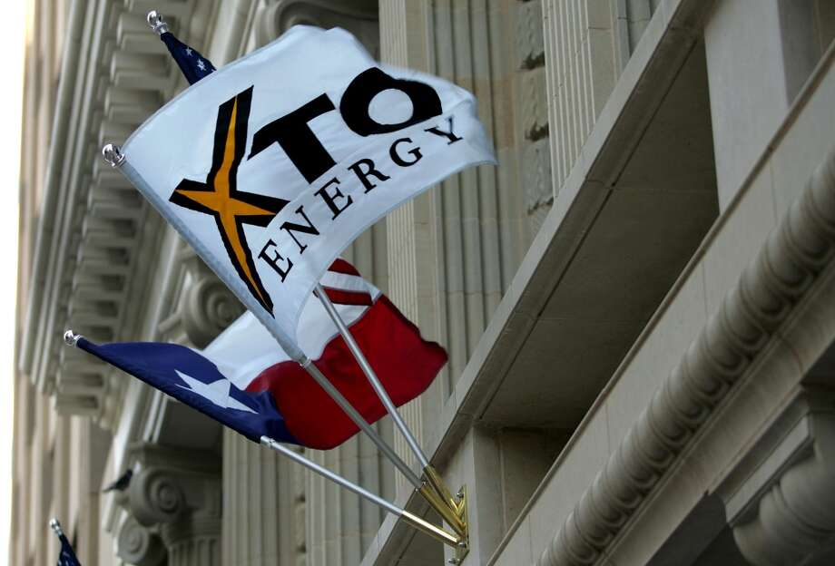 ExxonMobil buys XTO for $24.9 billion. Photo: RON JENKINS, AP