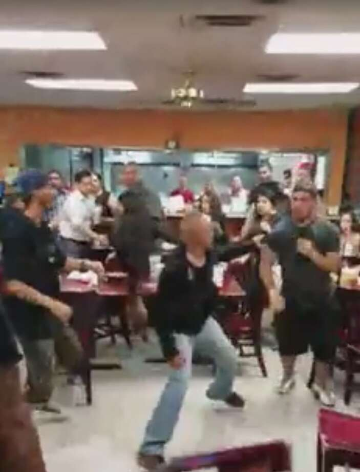 A late-night brawl, which overwhelmed a Dallas taquería in a slippery fiasco on June 25, 2016, allegedly erupted due to an argument over salsa and was all caught in a Facebook video garnering the attention of millions online. Photo: Facebook Video By Isael Rojas
