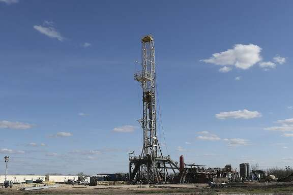 Work continues on a drilling rig off Texas State Highway 72 east of Tilden, Texas, Thursday, February, 19, 2015. A drop in the price of crude oil from has led to lower prices at the pump for consumers. Hovering close to $50 from a high of over $100 per barrel of oil has led to a slow down activity in the Eagle Ford Shale play.