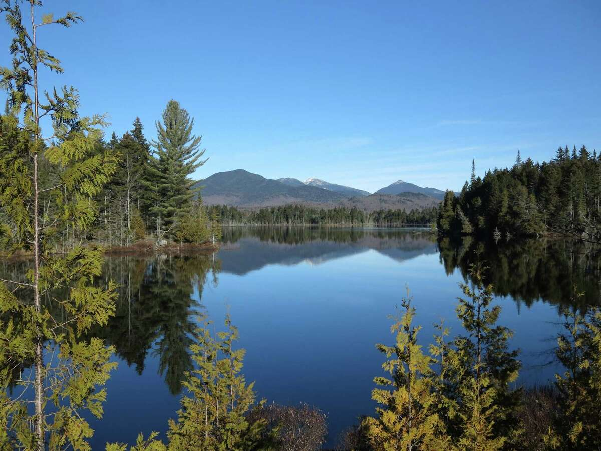 Click through to see some of the best hiking spots and views of the Adirondacks. Adirondack High Peaks, including snow-capped Mount Marcy, the state's highest summit, rear center, are reflected in Boreas Pond in North Hudson, N.Y. (AP Photo/Mary Esch, File)