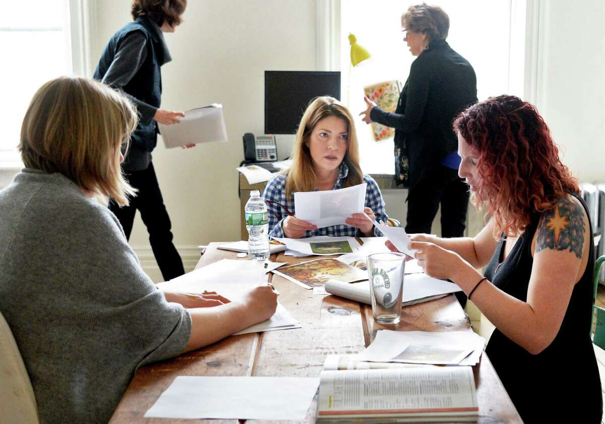 Editor-in-chief Sarah Gray Miller, center, and her staff work on the summer issue of Modern Farmer magazine in their Warren Street offices Tuesday May 3, 2016 in Hudson , NY. (John Carl D'Annibale / Times Union)