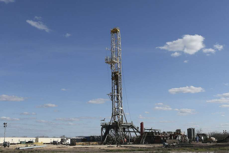 Work continues on a drilling rig in the Eagle Ford Shale play in 2015. Cabot Oil & Gas is the latest oil company to announce the sale of acreage in the South Texas oil field. Photo: File Photo /San Antonio Express-News / © 2015 San Antonio Express-News