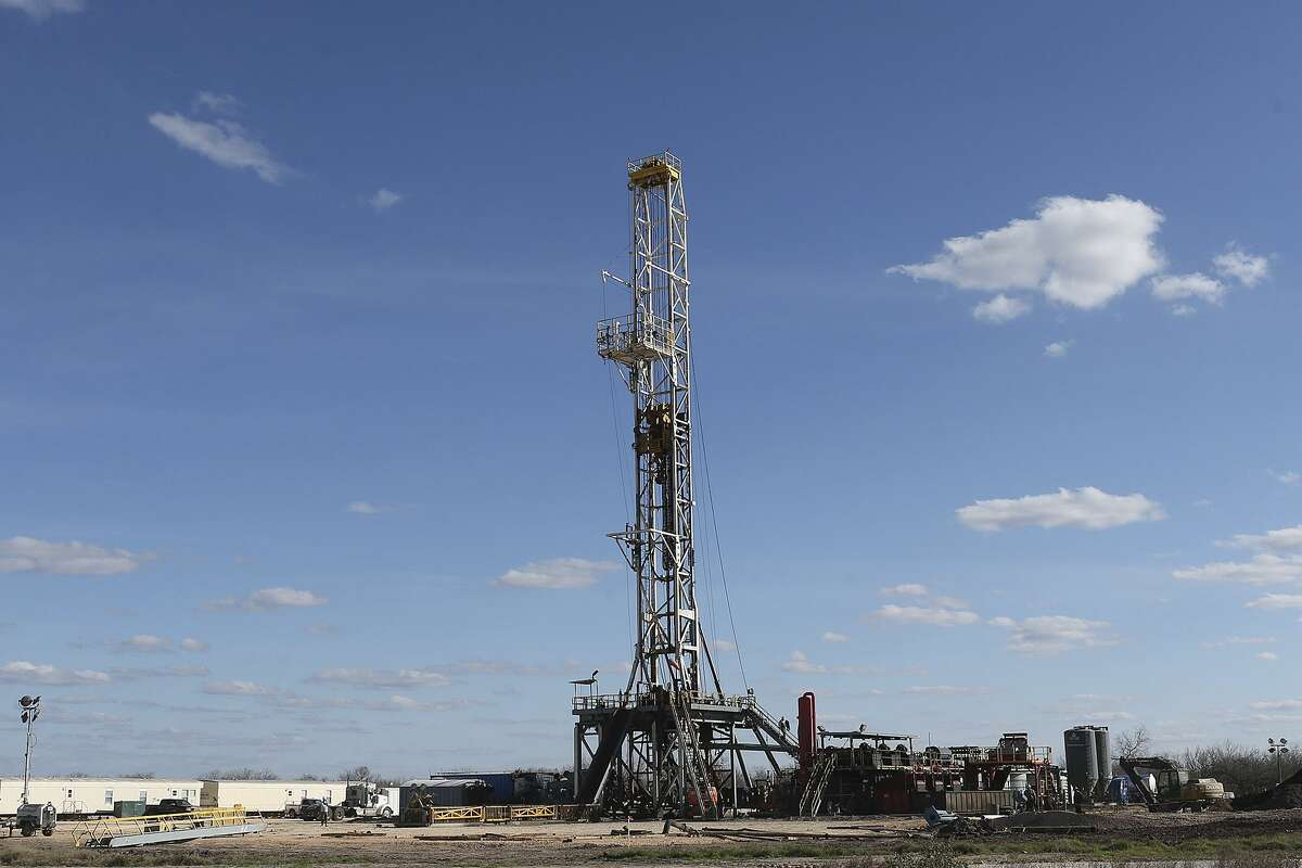 Work continues on a drilling rig off Texas State Highway 72 east of Tilden, Texas, Thursday, February, 19, 2015. The Permian Basin oil field in West Texas and Eagle Ford Shale oil field in South Texas both gained one drilling rig last week, according to the service company Baker Hughes.