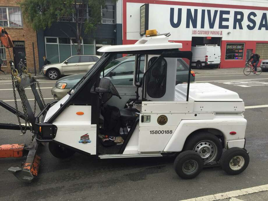 A San Francisco parking control officer suffered minor injuries Wednesday morning after her three-wheeled enforcement vehicle was hit by an SUV and knocked on its side in the city's South of Market area. Photo: Evan Sernoffsky / The Chronicle / /