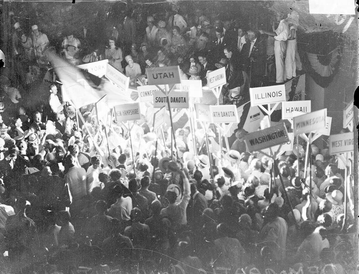 Image of crowds holding up signs with the names of states at the 1928 Democratic National Convention, held in Sam Houston Hall in Houston, Texas, June 1928. From the Chicago Daily News collection. (Photo by Chicago History Museum/Getty Images)