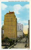 HOUSTON - 1928:  Vintage postcard showing a view looking west down Texas Avenue  A few skyscrapers can be seen and there are numerous automobiles parked along the street. (Photo by Lake County Museum/Getty Images)