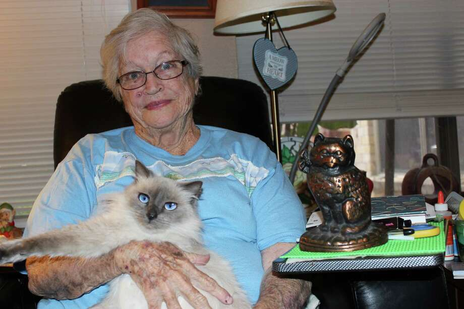 A $2,500 grant from Meals on Wheels America will support Fort Bend Seniors Meals on Wheels' Feeding Our Furry Friends program. Above, Barbara Phillips  cuddles her cat, Jill.