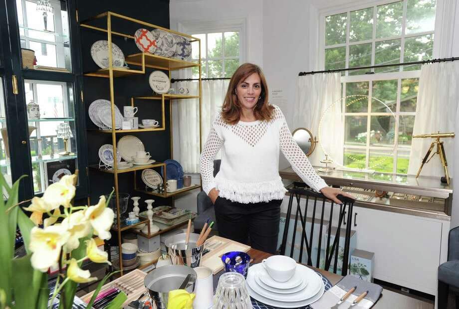 """Lisa Lori proprietor of the Perfect Provenance store in her store located at 47 Arch Street in Greenwich, Conn., Tuesday, June 28, 2016. The art-inspired luxury lifestyle store and cafe (that seats 12) is the creation of Lisa and her husband Mat Lori. According to Lisa Lori, every 8-10 weeks, a new art exhibition will be introduced that will inspire a new product mix that mirrors the art exhibition theme. The current exhibition """"We'll Always Have Paris,"""" is Parisian inspired and taken from the black and white film classic """"Casablanca."""" Photo: Bob Luckey Jr. / Hearst Connecticut Media / Greenwich Time"""