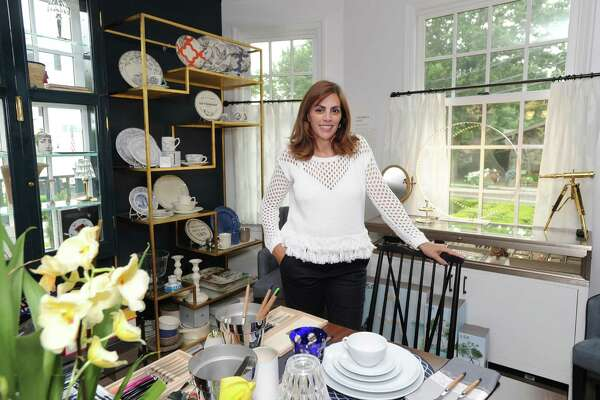 "Lisa Lori proprietor of the Perfect Provenance store in her store located at 47 Arch Street in Greenwich, Conn., Tuesday, June 28, 2016. The art-inspired luxury lifestyle store and cafe (that seats 12) is the creation of Lisa and her husband Mat Lori. According to Lisa Lori, every 8-10 weeks, a new art exhibition will be introduced that will inspire a new product mix that mirrors the art exhibition theme. The current exhibition ""We'll Always Have Paris,"" is Parisian inspired and taken from the black and white film classic ""Casablanca."""