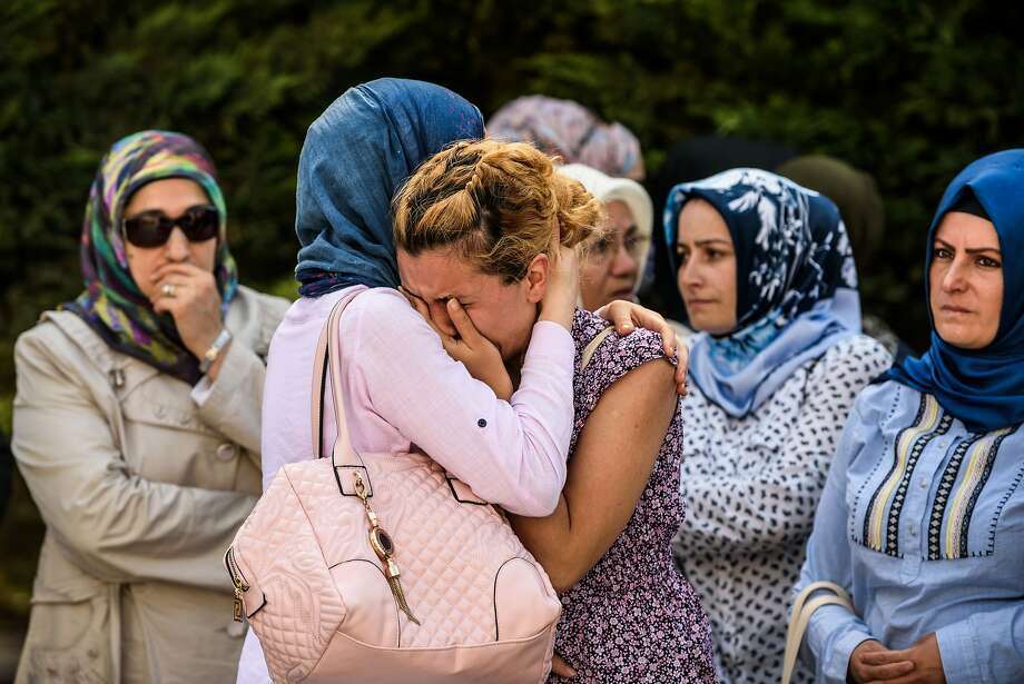 Relatives of a Turkish victim mourn in Istanbul during his funeral a day after a suicide bombing and gun attack targeted the city's Ataturk Airport. Photo: OZAN KOSE, AFP/Getty Images