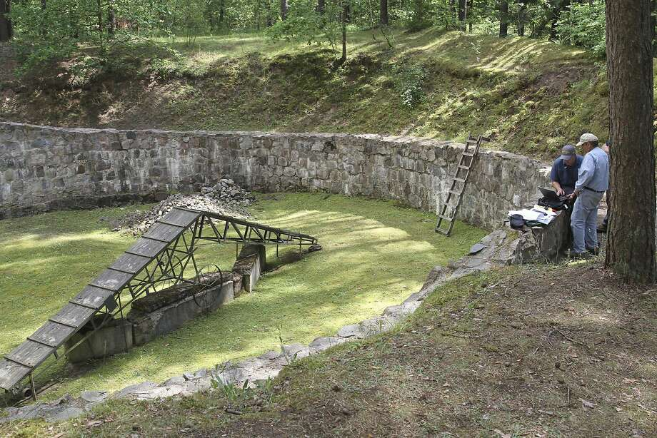 Archaeologists uncovered the forgotten tunnel in this burning pit at Ponar, a Nazi extermination site near Vilnius, Lithuania. Eleven prisoners escaped and survived the war. Photo: EZRA WOLFINGER FOR NOVA, NYT