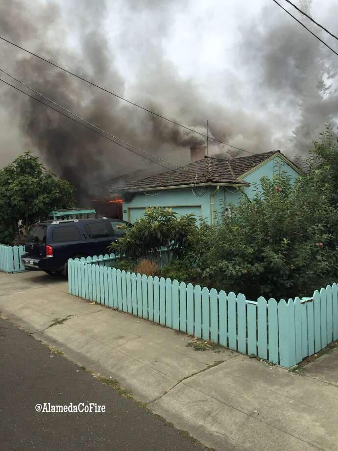 A young girl was taken to a hospital with life-threatening injuries after Alameda County firefighters rescued her from a burning house in an unincorporated neighborhood between San Lorenzo and Hayward. Two boys were also injured in the blaze. Photo: Alameda County Fire Department / /