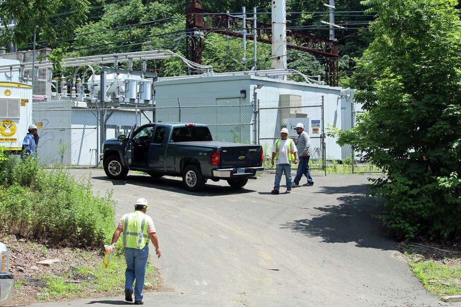 A brush fire was reported, and possibly a downed electrical line, along the Metro-North tracks in Westport on Wednesday, June 29, 2016. Photo: Thane Grauel / Hearst Connecticut Media / Connecticut Post