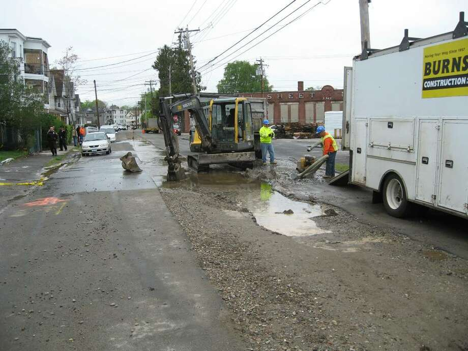 Ash Street on the city's West End was closed for most of the day on Monday after a water main break collapsed the street in at least three places. Photo: John Burgeson / Connecticut Post