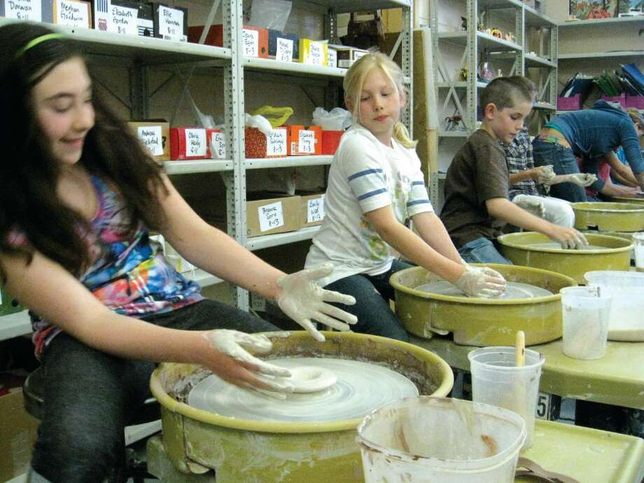 Ten-year-olds Sarah Bazata, Chloe McAuliffe and Cody Rilling test out the pottery wheel, an art tool usually reserved for students in grade eight and above. Photo: Brittany Lyte / New Canaan News