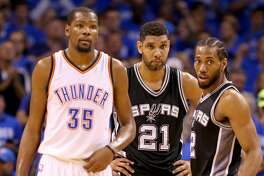 Oklahoma City Thunder's Kevin Durant, San Antonio Spurs' Tim Duncan, and Kawhi Leonard pause during second half action of Game 6 in the Western Conference semifinals Thursday May 12, 2016 at Chesapeake Energy Arena in Oklahoma City, Oklahoma. The Thunder won 113-99.