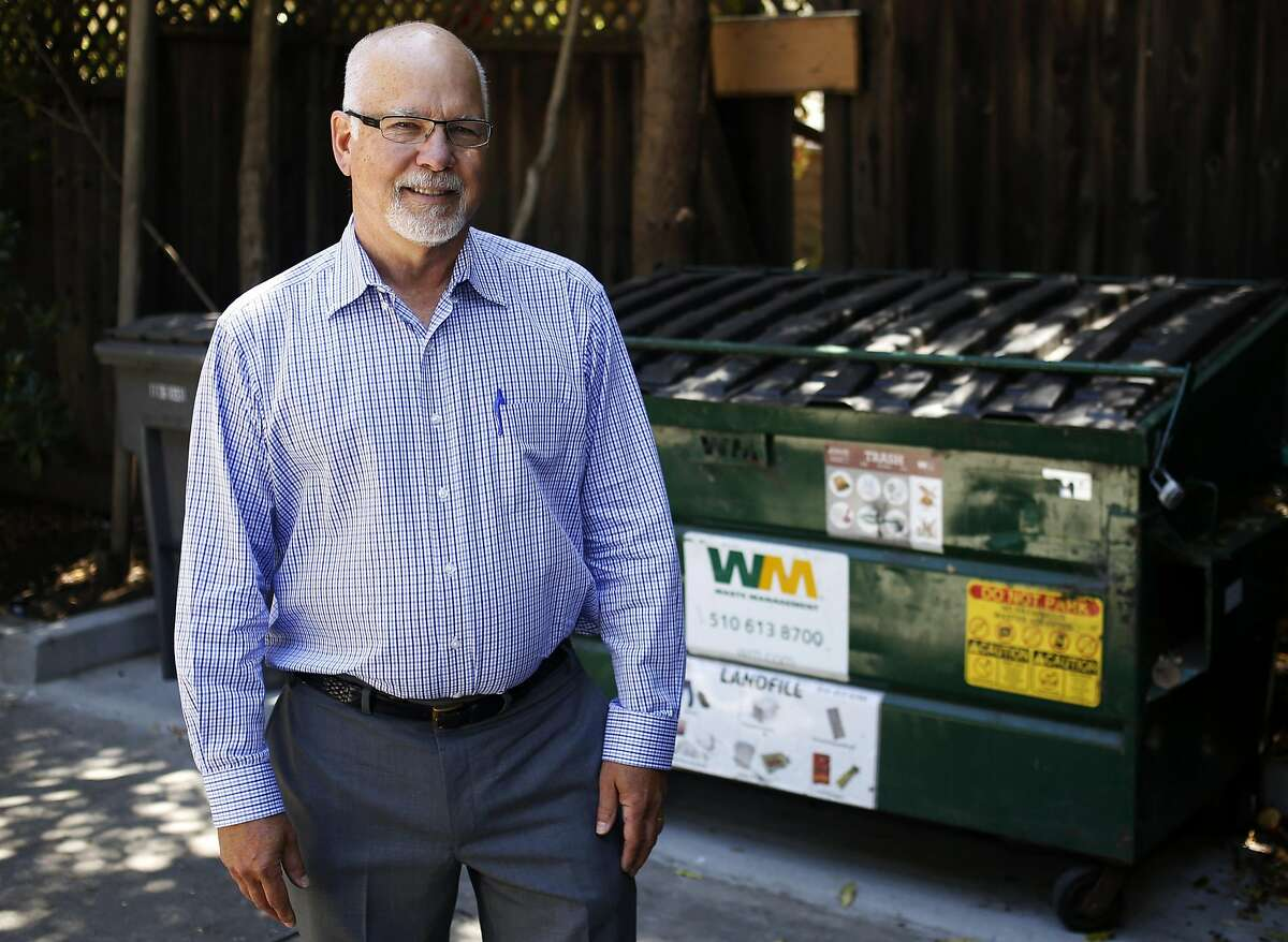 Co-plaintiff Stephen Clayton stands near the garbage cans at a rental property he owns in Oakland, California, on Wednesday, June 29, 2016.