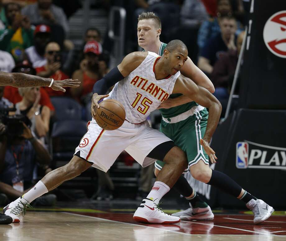 FILE - In this April 26, 2016, file photo, Atlanta Hawks center Al Horford (15) drives against Boston Celtics forward Jonas Jerebko during the first half of Game 5 of an NBA basketball first-round playoff series in Atlanta. (Toronto's DeMar DeRozan, Atlanta's Al Horford, Memphis point guard Mike Conley and Houston's Dwight Howard are among those who figure to become free agents this summer when the NBA's new television deal will kick in. (AP Photo/John Bazemore, File) Photo: John Bazemore, Associated Press