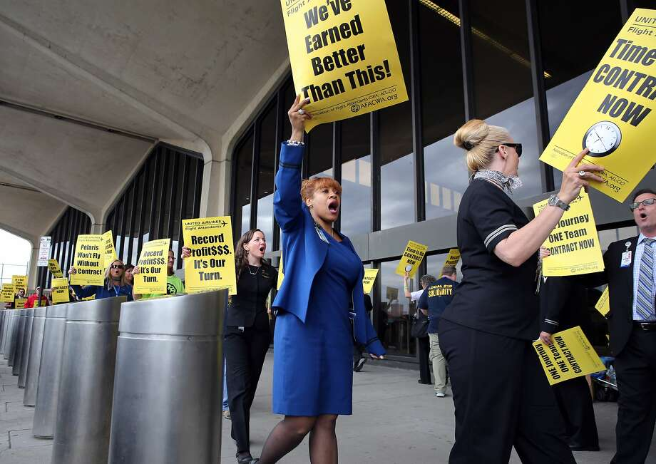 United Airlines flight attendants picket at Newark airport in New Jersey this month. A new contract will unite them with their Continental colleagues. Photo: RICHARD PERRY, NY